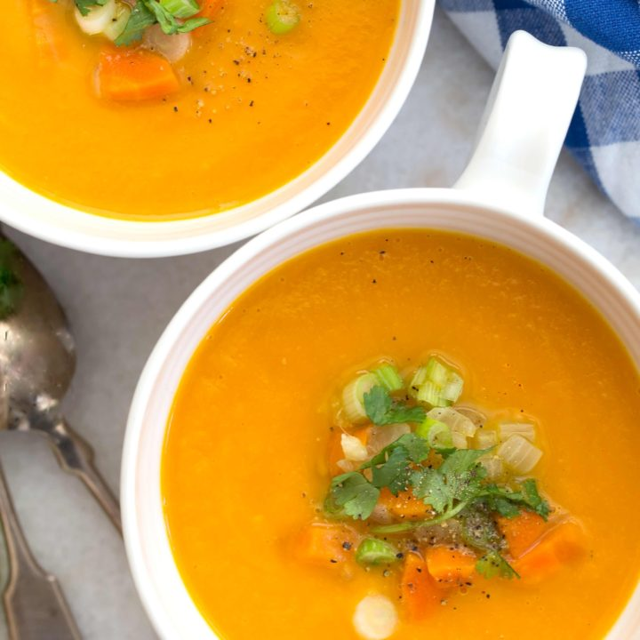 This Carrot Ginger Soup Recipe is made with carrots, celery, onion, ginger and garlic simmered in a vegetable broth, then blended until smooth and silky