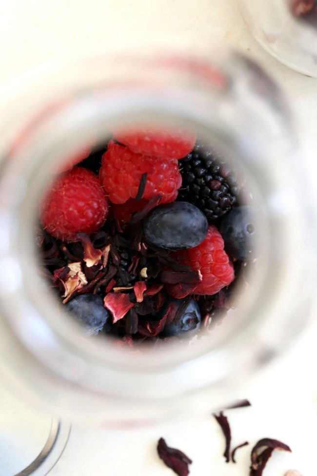 glass filled with dried hibiscus leaves and berries