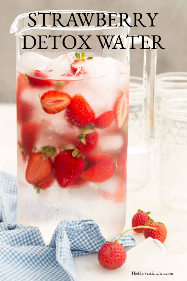 pitcher of water with strawberries