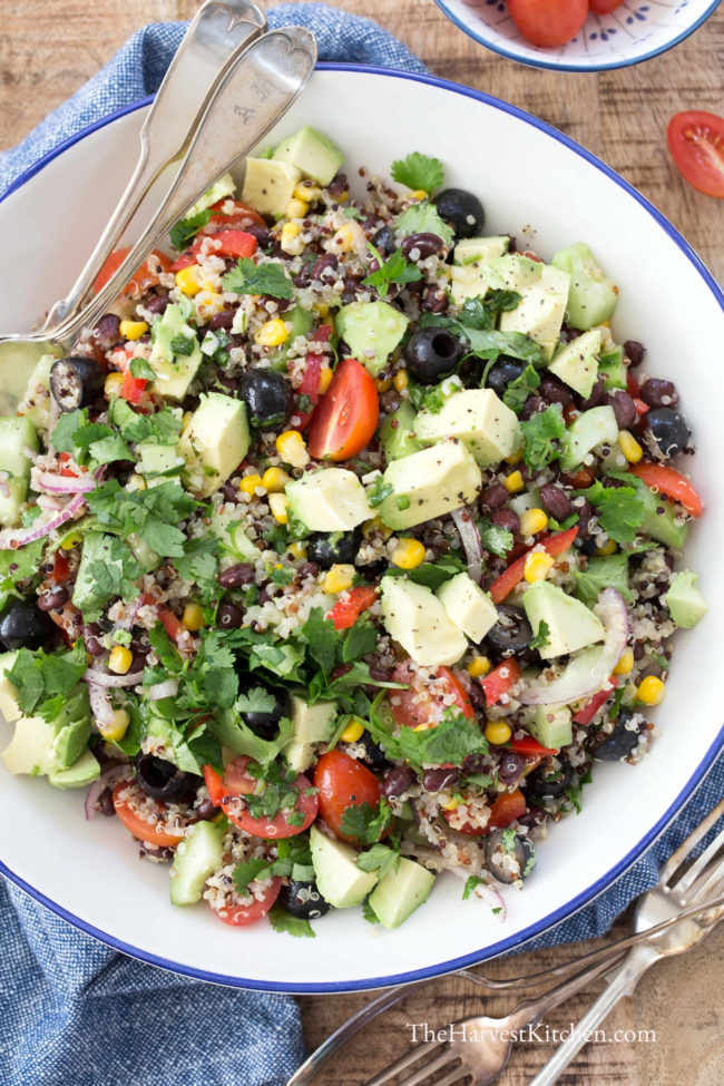 Quinoa Black Bean Salad is busy with quinoa, black beans, corn, black olives, red pepper, onion, cilantro, avocado all tossed in a honey lime vinaigrette