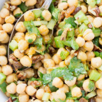 This Curried Chickpea Salad is a simple salad made with garbanzo beans, raisins, pecans, parsley and celery all tossed in a delicious curry salad dressing