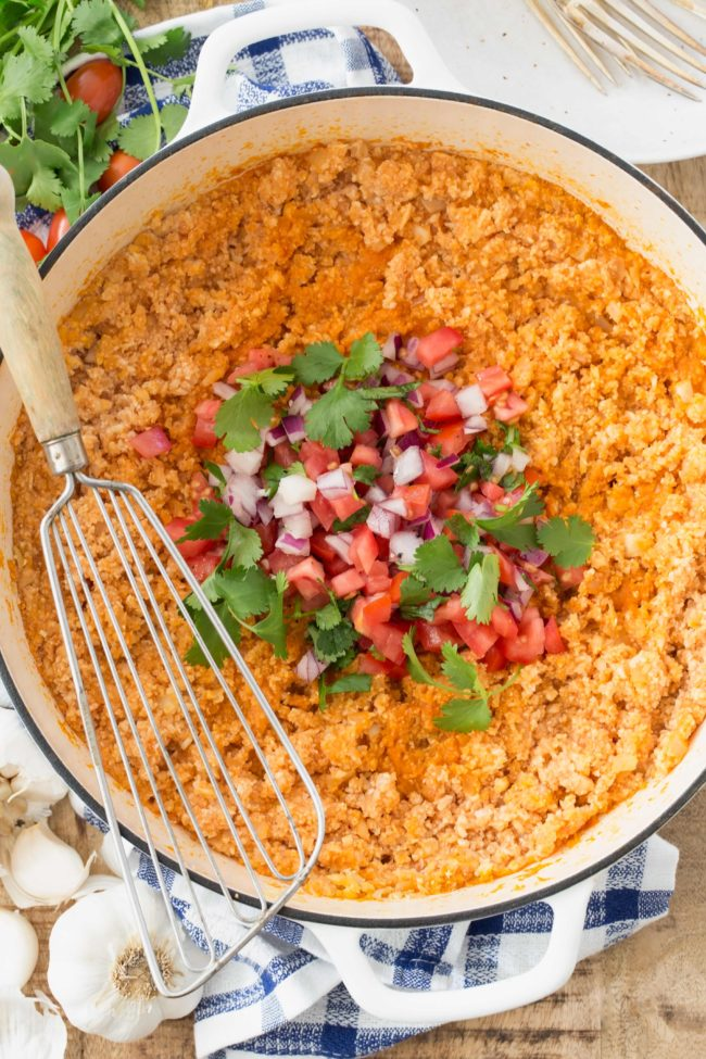 Mexican Cauliflower Rice (also called Spanish Cauliflower Rice) is made with cauliflower rice, onion, garlic, vegetable broth, tomato paste and seasoning
