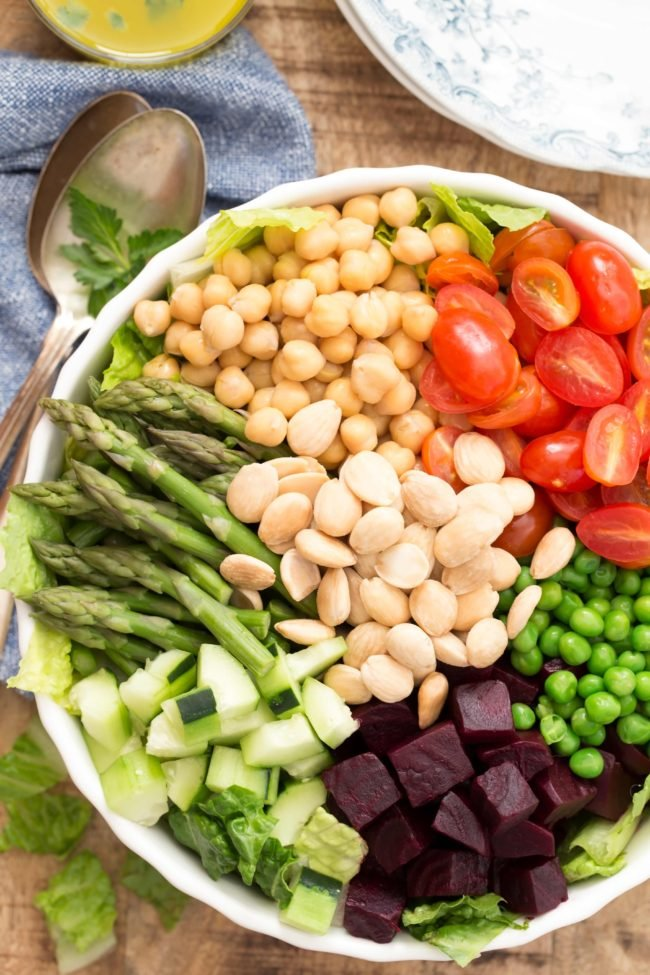 This House Salad is a delicious mix of Romaine lettuce, asparagus, beets, peas, blueberries, avocado, tomatoes, chickpeas and Marcona almonds