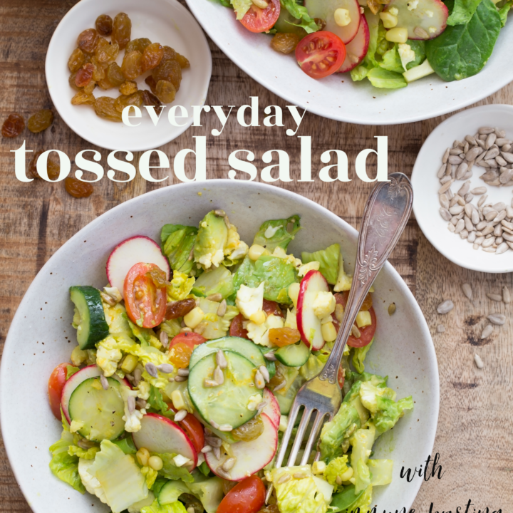 This Everyday Tossed Salad is an easy garden salad blend of mixed greens, cucumber, cauliflower, tomatoes, corn, radishes and avocado