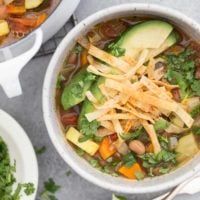 This Vegan Tortilla Soup is loaded with vegetables, onion and garlic, pinto beans and authentic Mexican seasoning all simmered in a richly flavored broth