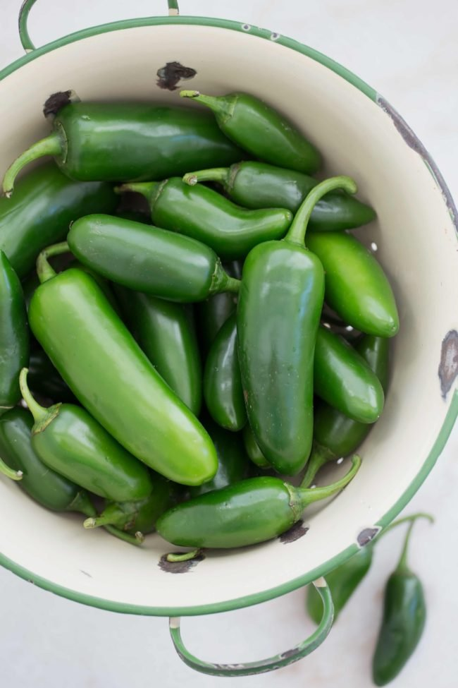 These slightly spicy Pickled Jalapenos are quick and easy to make and they're great to add to tacos, nachos, burgers and more