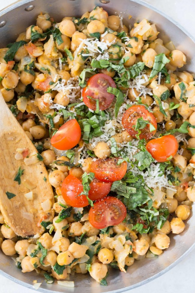 This Spinach and Chickpeas recipe is quick and easy to make using only canned chickpeas, tomatoes, spinach, onion and garlic