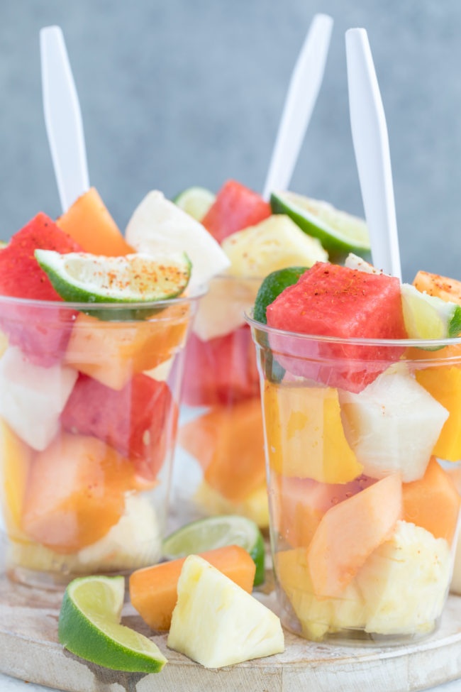 These Mexican-style Fruit Cups are made with fresh pineapple, mango, papaya, watermelon, cantaloupe, jicama, and drizzled with lime and seasoned with Tajin