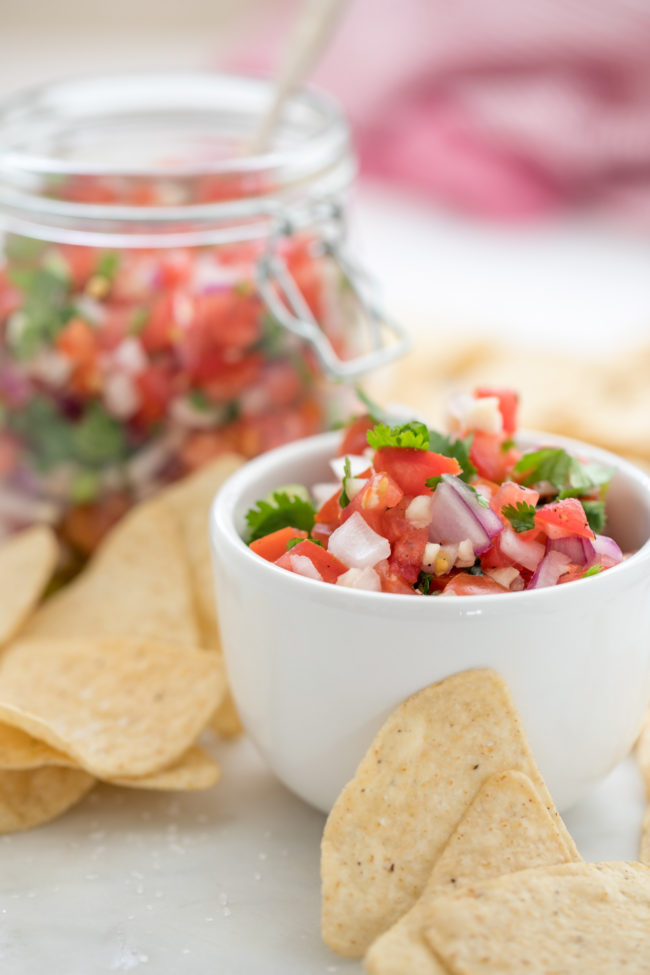 This easy Pico de Gallo Recipe (also referred to as salsa fresca) is a versatile recipe that's made with fresh tomatoes, onion, garlic, jalapeno, cilantro and lime juice