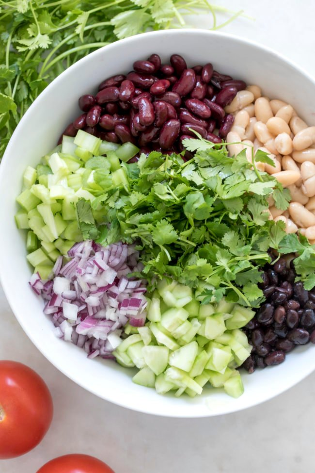 This Bean Salad Recipe is loaded with black beans, kidney beans, cannellini beans, vegetables and cilantro all tossed in a jalapeno lime vinaigrette