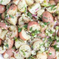 This Red Potato Salad is made with baby red potatoes, onion, celery and lots of fresh herbs all tossed in a light and delicious lemon vinaigrette