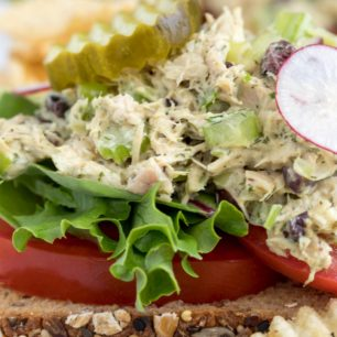 This Tuna Salad Sandwich is made with canned tuna, celery, onions and kalamata olives all tossed in a light mayonnaise dressing