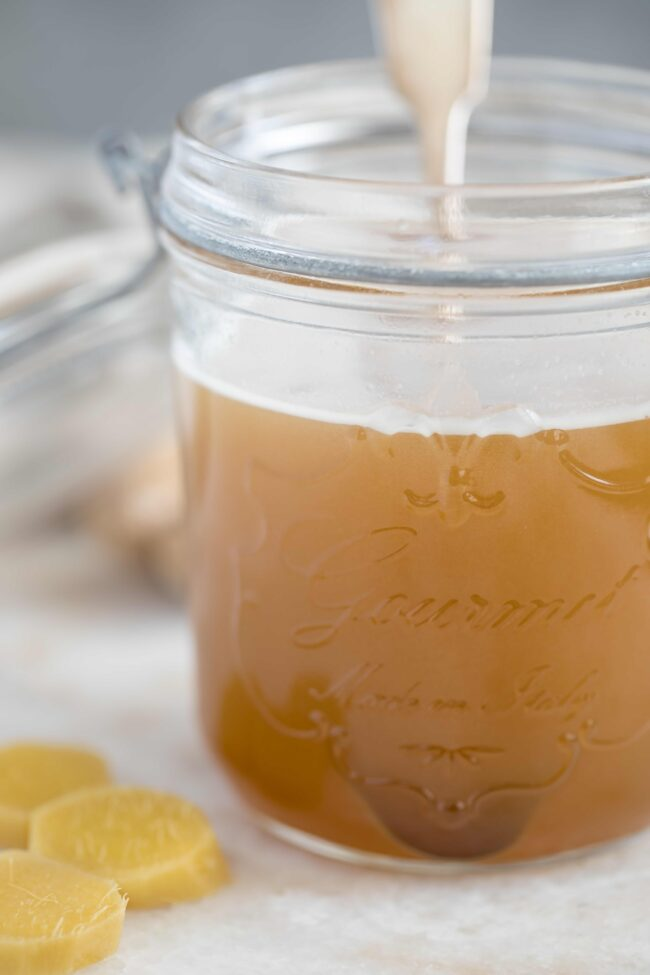 This Ginger Syrup Recipe is made with ginger juice and honey, and it adds a pop of flavor and added nutrition when added to water, tea and club soda