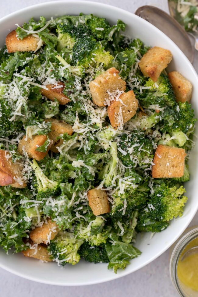 broccoli and kale salad in a white bowl