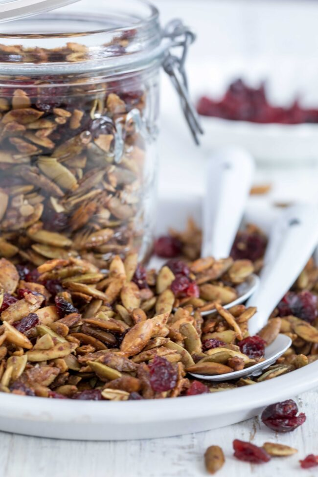 dish with roasted pumpkin seeds and dried cranberries
