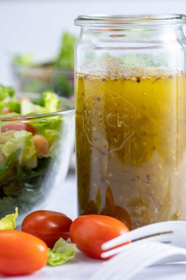 glass jar filled with Italian salad dressing