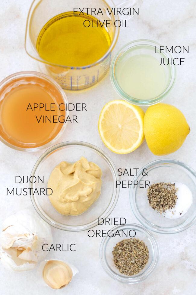 glasses filled with apple cider vinegar dressing ingredients