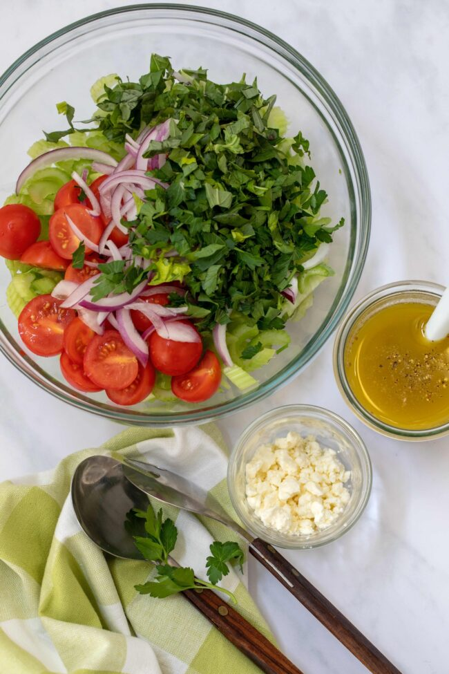 bowl of celery salad with tomatoes
