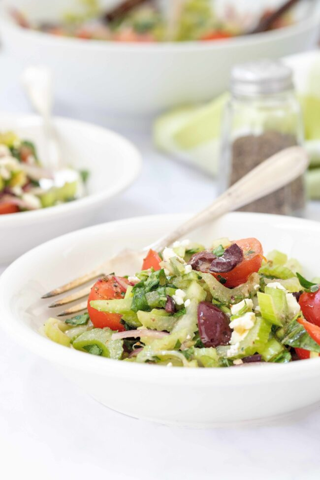 bowls of chopped celery with tomatoes