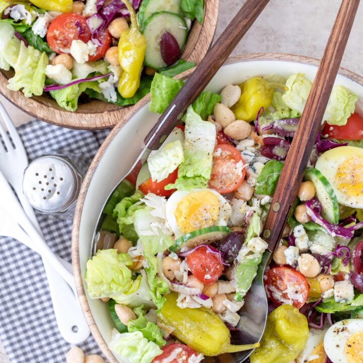 bowls of salad tossed in gorgonzola dressing
