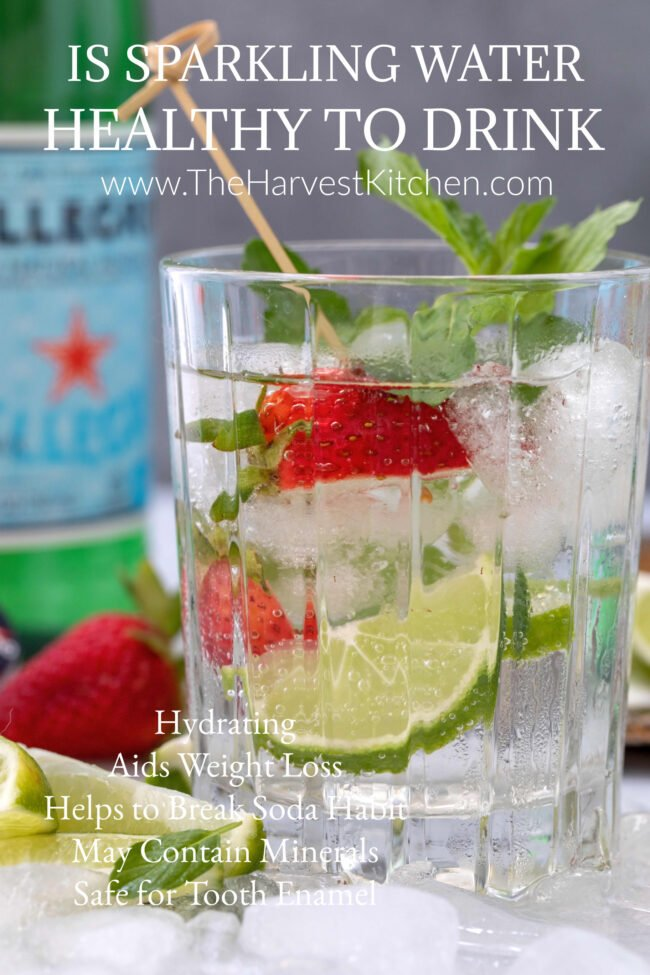 drinking glass filled with sparkling water and fruit