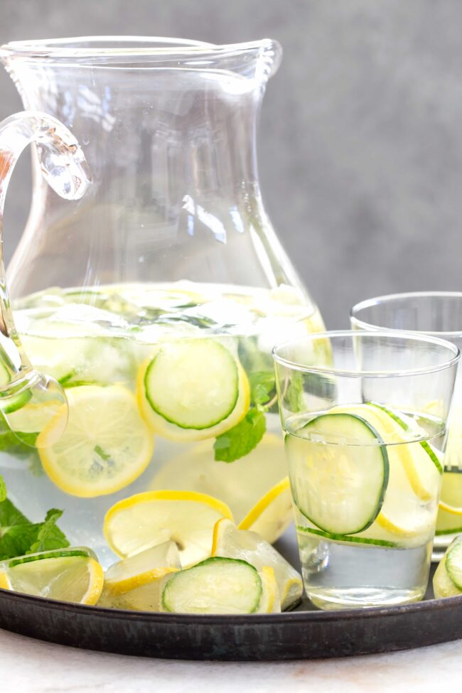 pitcher of water withe cucumber and lemon slices
