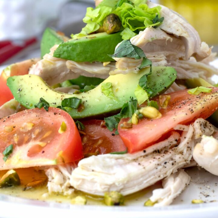 plate of chicken and avocado