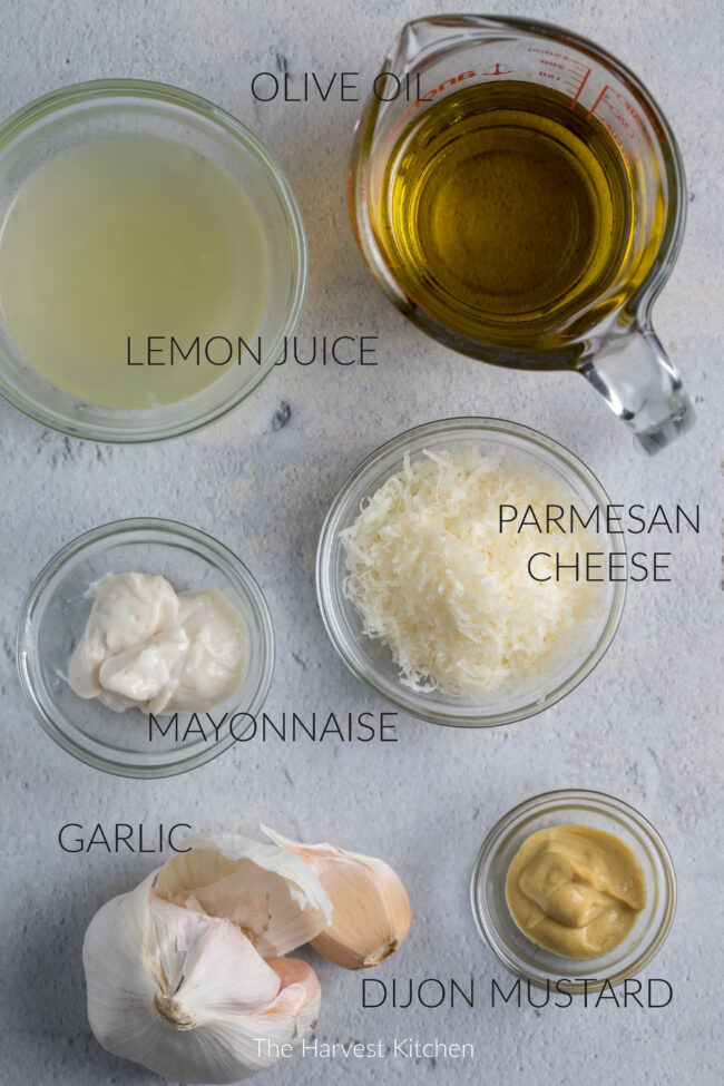jars with ingredients for Caesar salad dressing